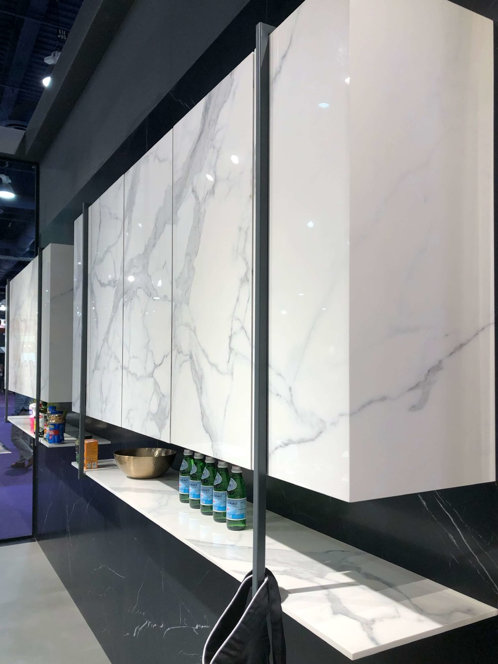 Marble look porcelain slabs used as cabinetry fronts from Sapienstone | KBIS 2019 Surfaces Trends