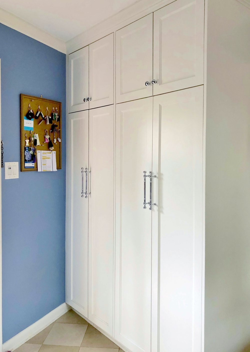 Periwinkle blue laundry room with full height cabinet storage | Carla Aston, Designer
