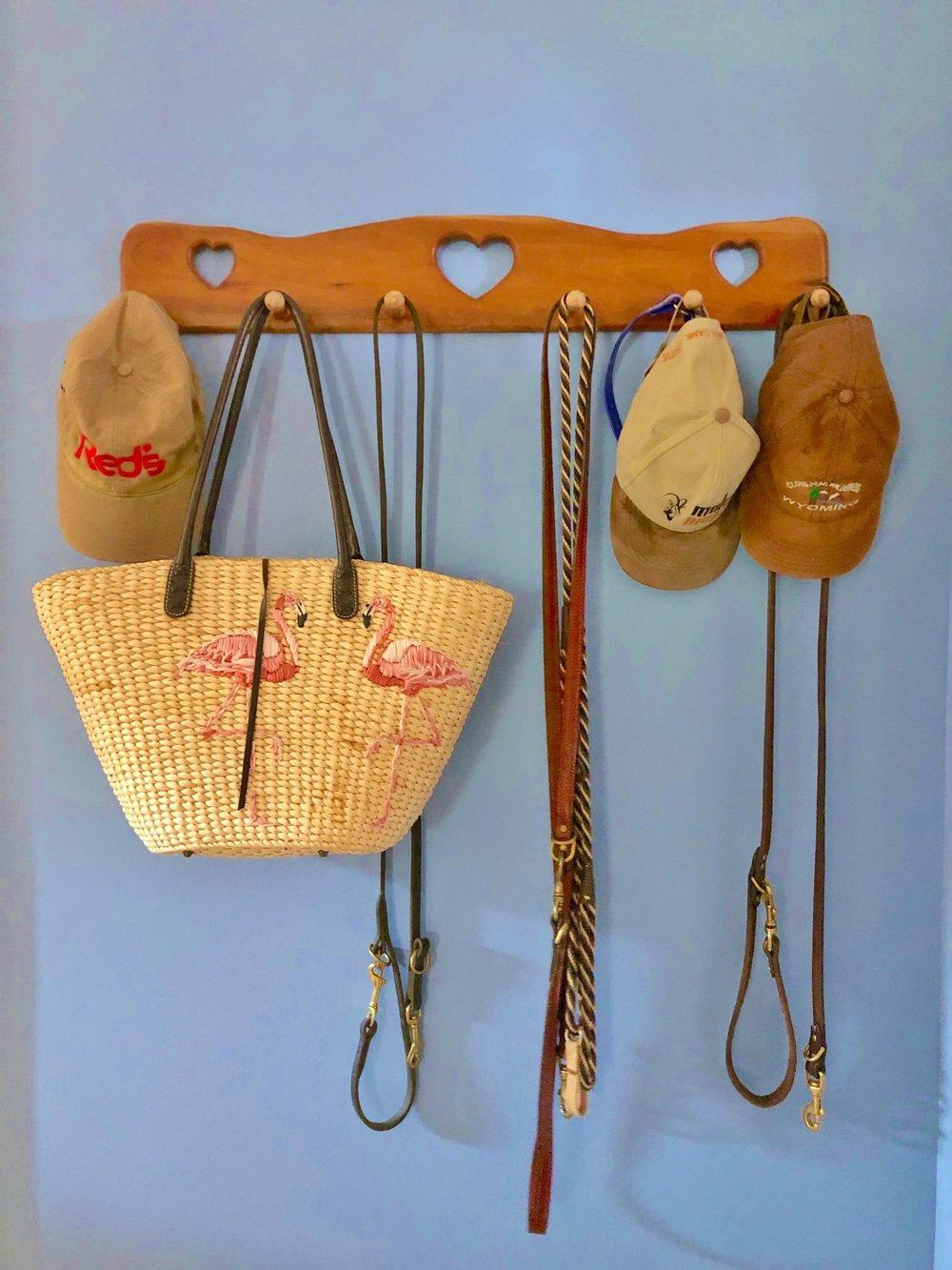 Handmade wood hat rack in periwinkle blue laundry room | Carla Aston, Designer