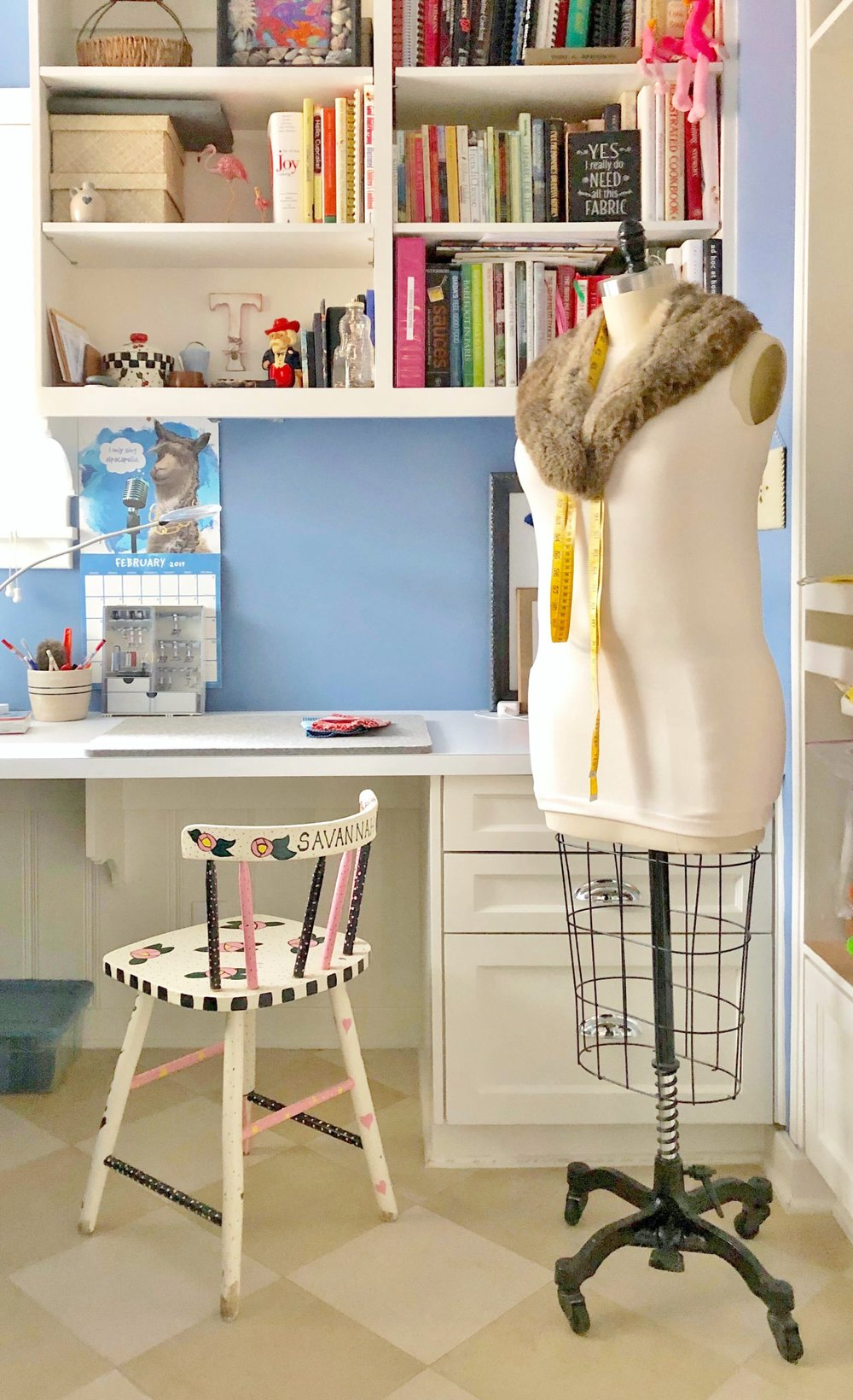 Periwinkle blue sewing craft room with built-in cabinetry, shelving and work surfaces | Carla Aston, Designer