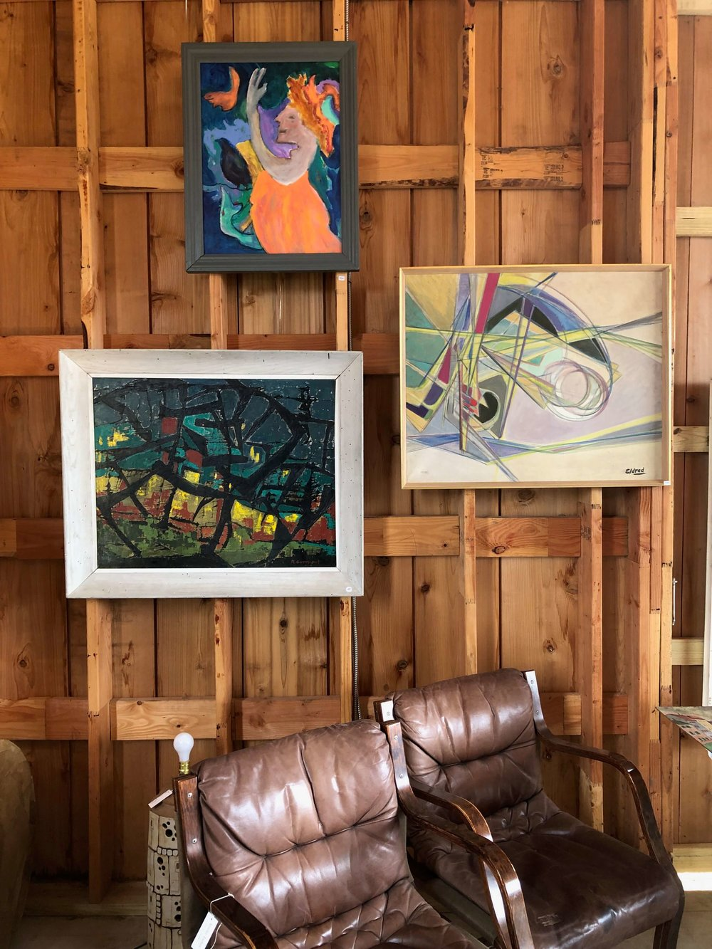 Loving this art grouping. I'll take it all! Art and vintage furniture seen at The Compound, Round Top Antiques Fair
