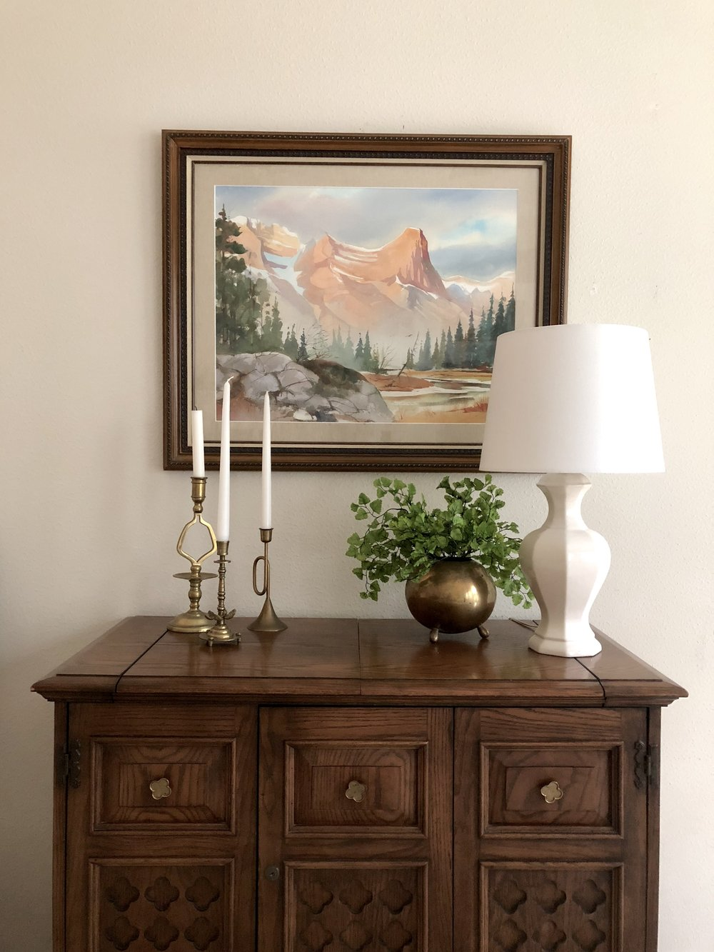 Simple vignette in the house, staged for sale.
