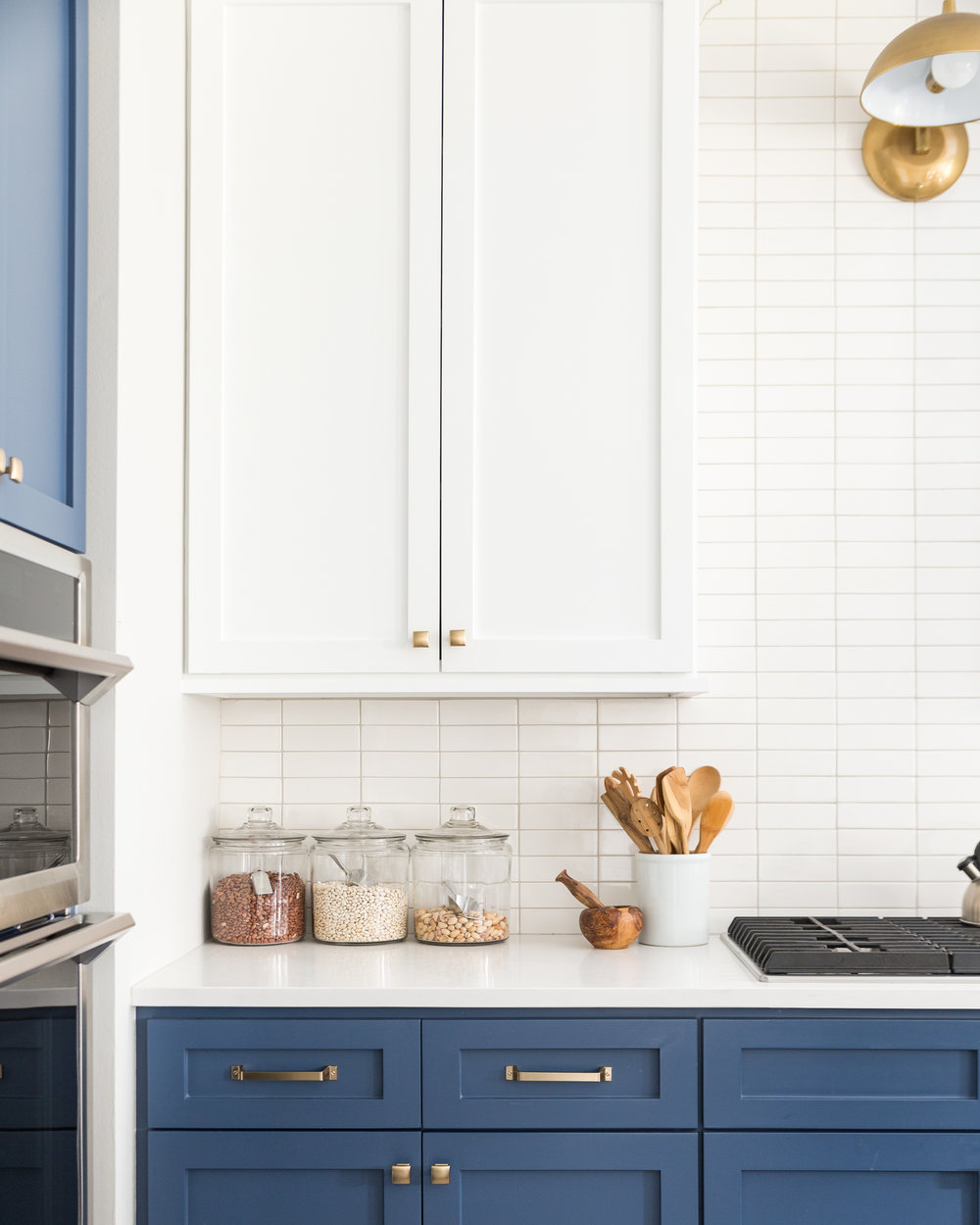 DESIGN TRICK - Kitchen with upper cabinets blended to match backsplash | Designer: Carla Aston, Photographer: Colleen Scott