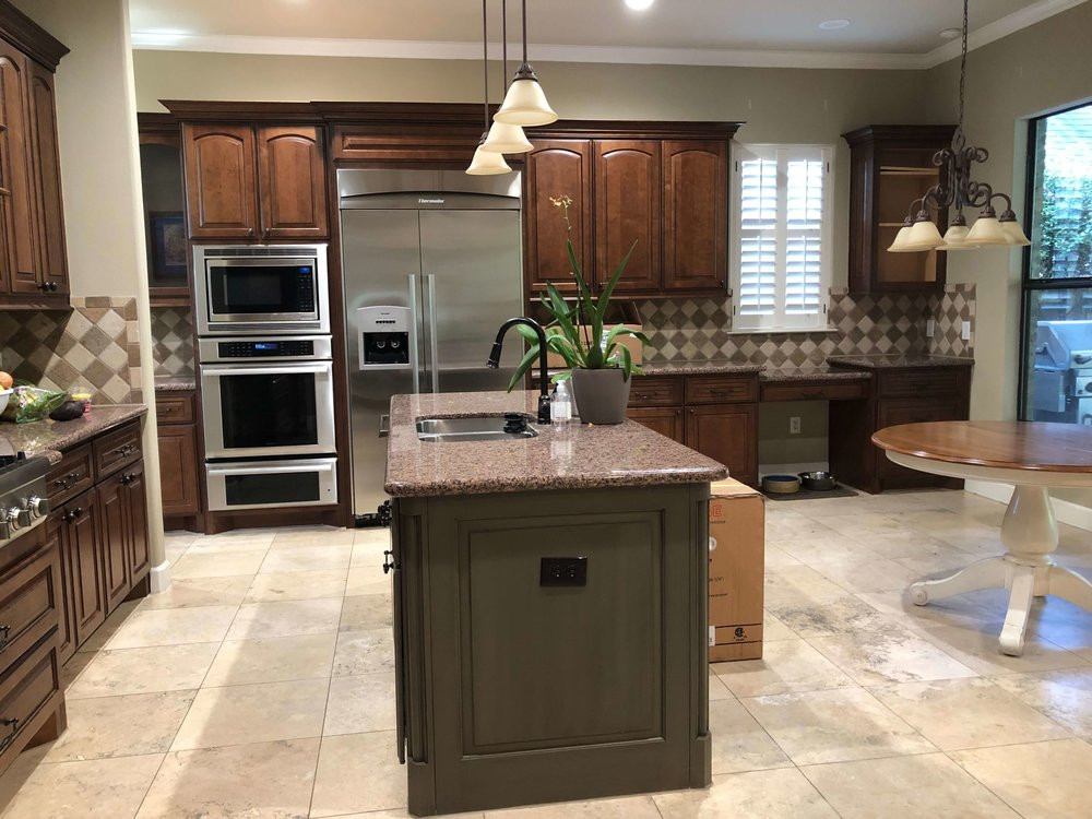 BEFORE - Kitchen to be remodeled. The all brown/warm toned look did not appeal to this homeowner.