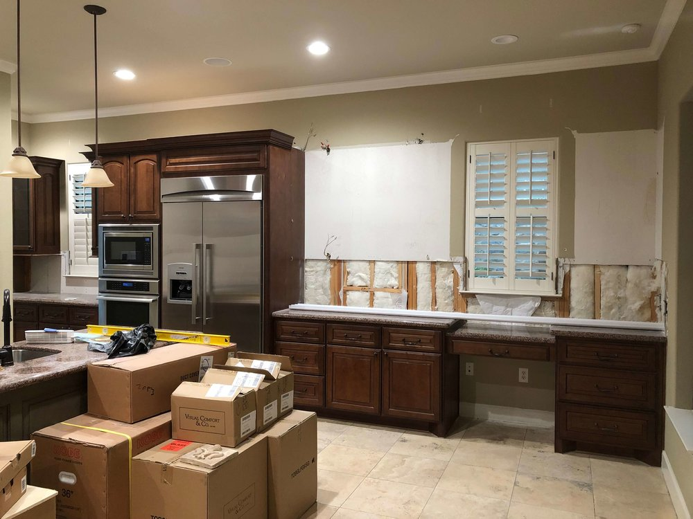 IN PROGRESS - The first demo of upper cabinets.