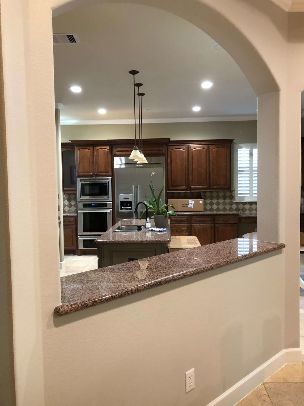 BEFORE - We took down this short bar wall and the arch to open the kitchen up more to the family room. #kitchenremodel