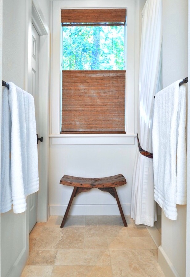 Top/down, bottom/up woven wood shades used in a bathroom to maintain privacy and still gain natural light in the space. Carla Aston, Designer | Miro Dvorscak, Photographer