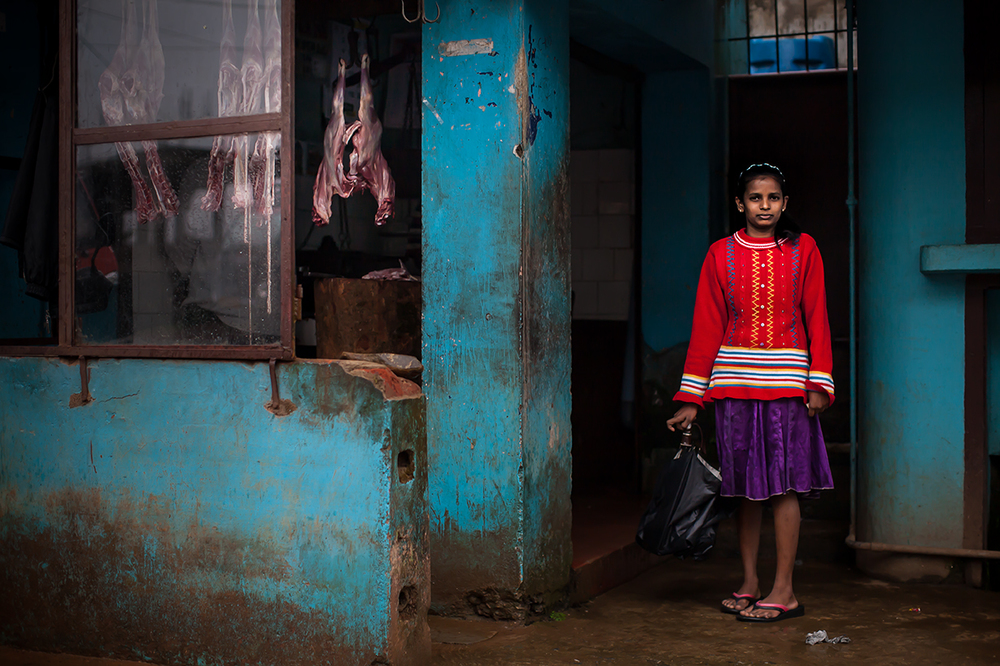 Girl waits for father outside of butcher in Madikeri 72.jpg