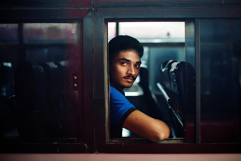 man waits in bus at bangalore 2 72.jpg