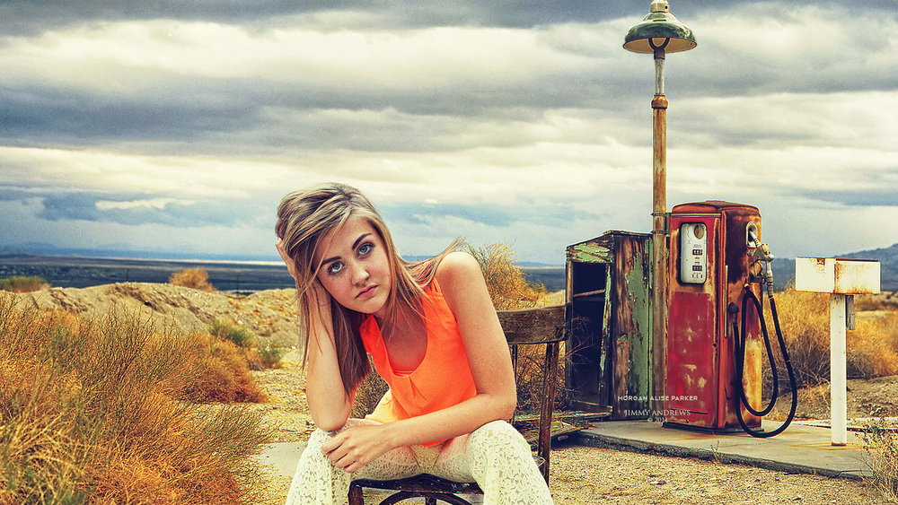 Morgan Parker Sitting In Front of Abandoned Gas Station