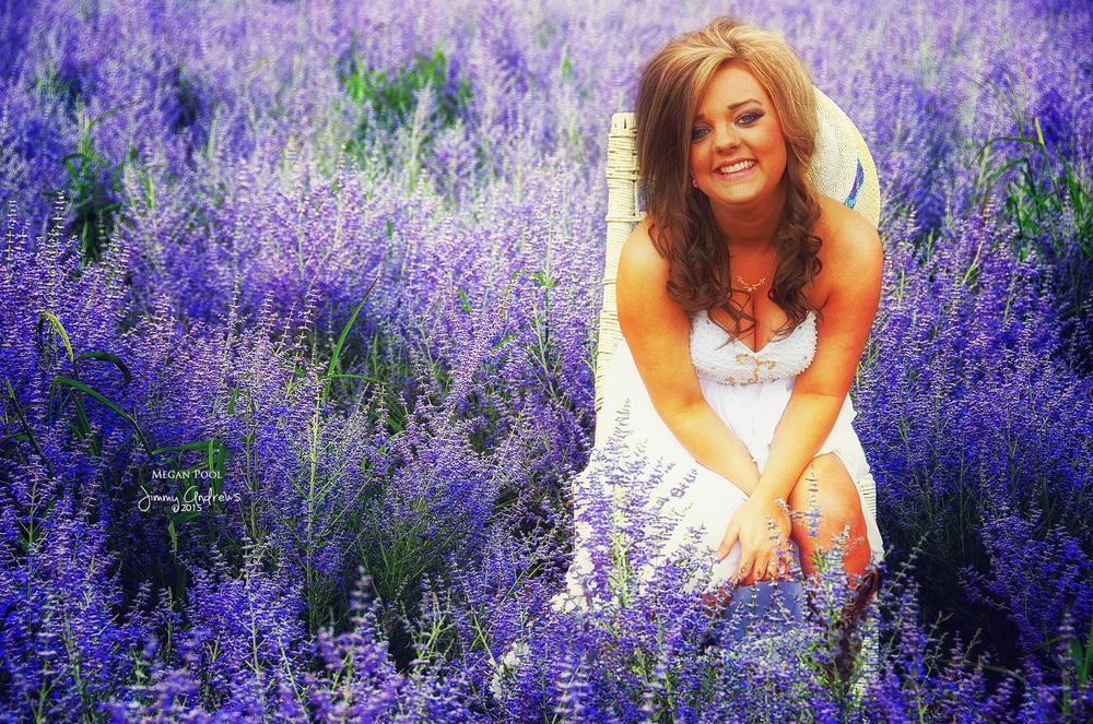 Megan Pool sitting in field of flowers