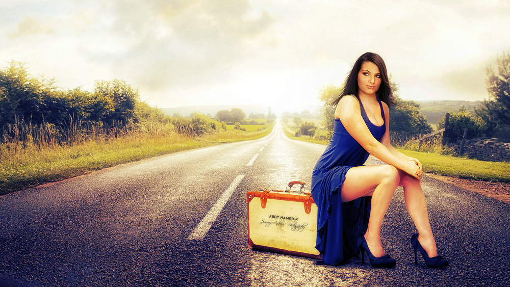 Abby Hamrick Sitting On Old Suitcase In Road