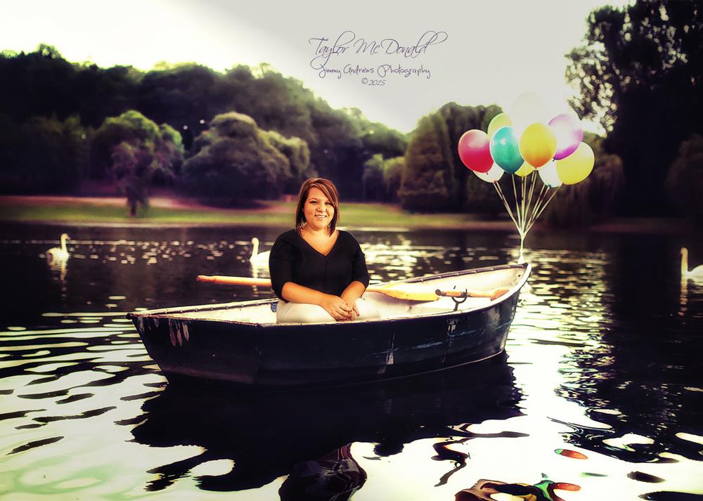 Taylor In Pond Boat.jpg