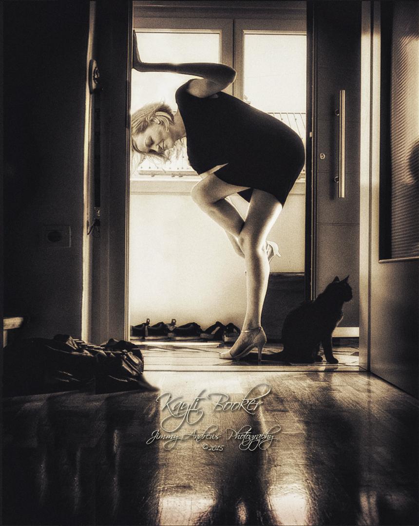 Kayti Booker Putting On Heels In Doorway