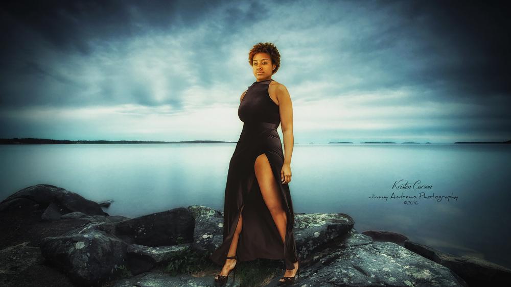 Kristen Carson In Black Dress On Rocks