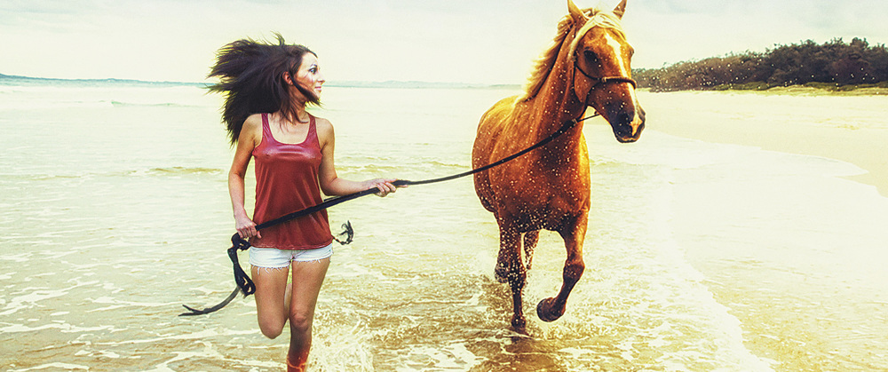 Jessica Bagley Running With Horse On Beach