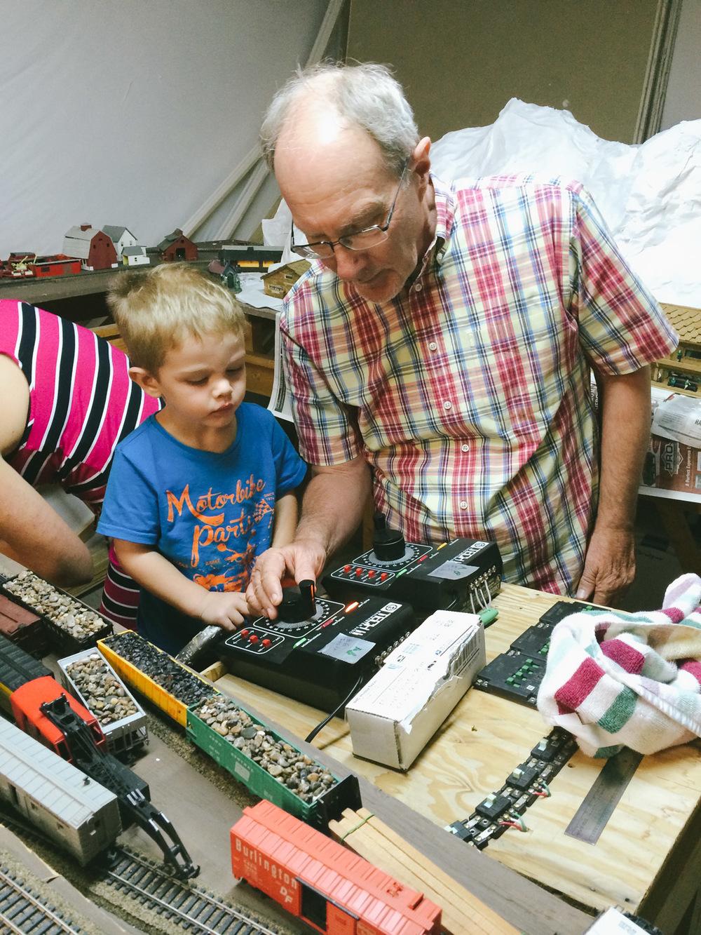 Caleb loved the trains at Grandpa's!