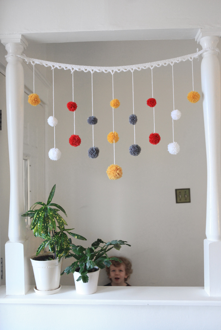 pom pom garland with crochet lace trim