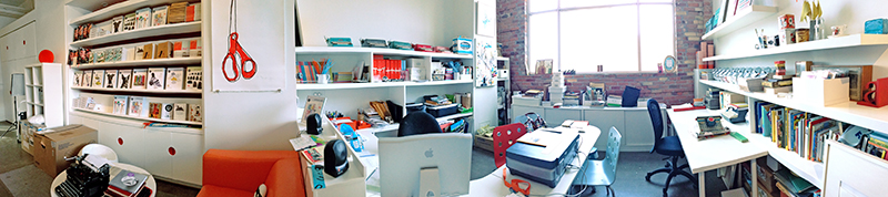 As I left for home yesterday, I paused to take this panoramic iPhone picture of UPPERCASE headquarters (mess and all!) Click to view it larger.