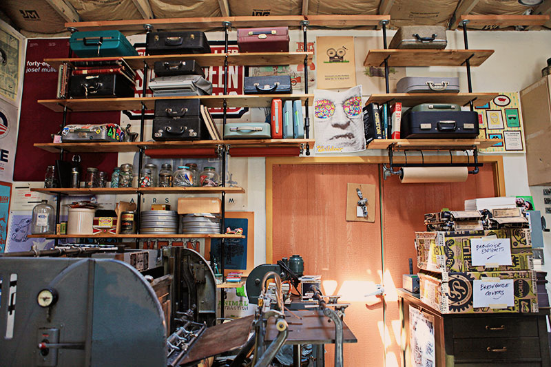 Brad's collection of typewriters are housed in their cases on a shelving system he devised.