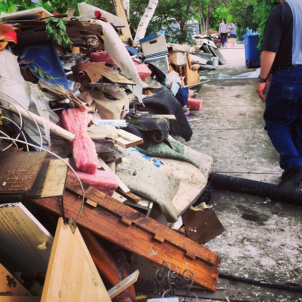 Debris hauled out of flooded basements lined the streets of Sunnyside.