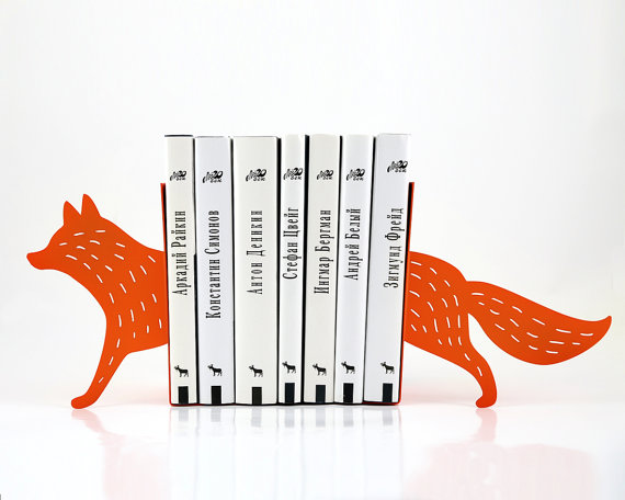 A charming fox-shaped book-end in the same orange as the UPPERCASE office decor.