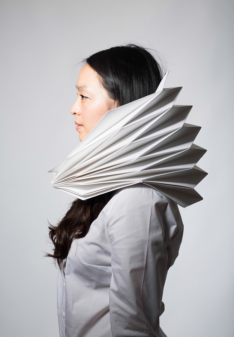 "Prototype for Nuit Blanche installation : a folded 24""x36"" sheet of paper. Photo by Don Toye, modelled by Eunsung Yoon."
