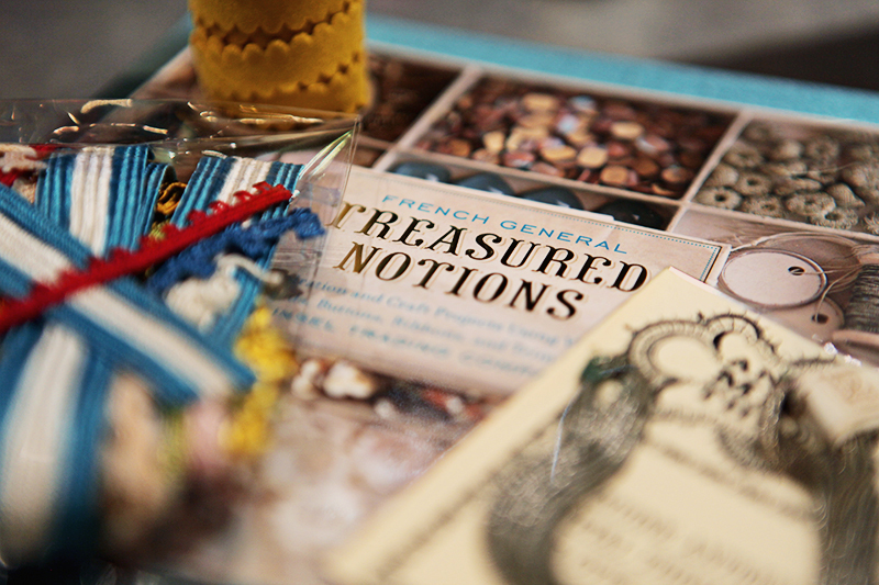 My purchases: a spool of yellow trim, a package of assorted vintage trim from the Tinsel Trading archives, some vintage thread and French General's book  Treasured Notions  featuring supplies from Tinsel Trading Company. (Published by Chronicle Books.)