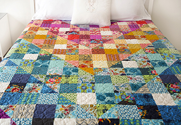 COLOR DIVE HALF SQUARE TRIANGLE QUILT   Anna Maria Horner