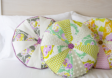 ROUND BUTTON CARTWHEEL PILLOW Heather Bailey