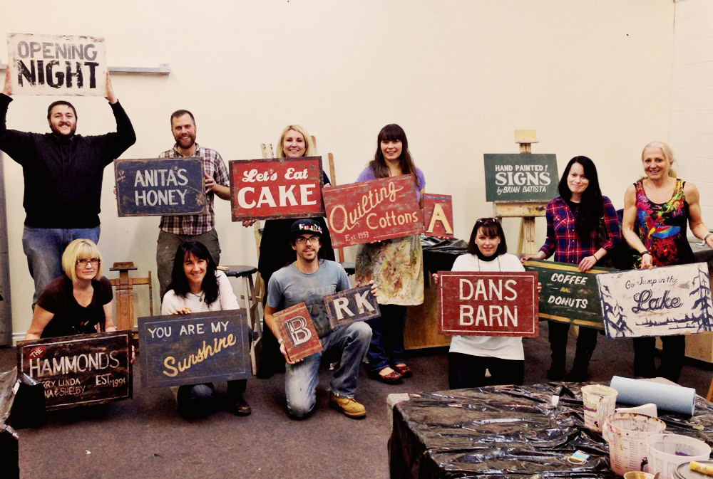 Happy students who participated in Rick Janzen's distressed signage workshop earlier this year.