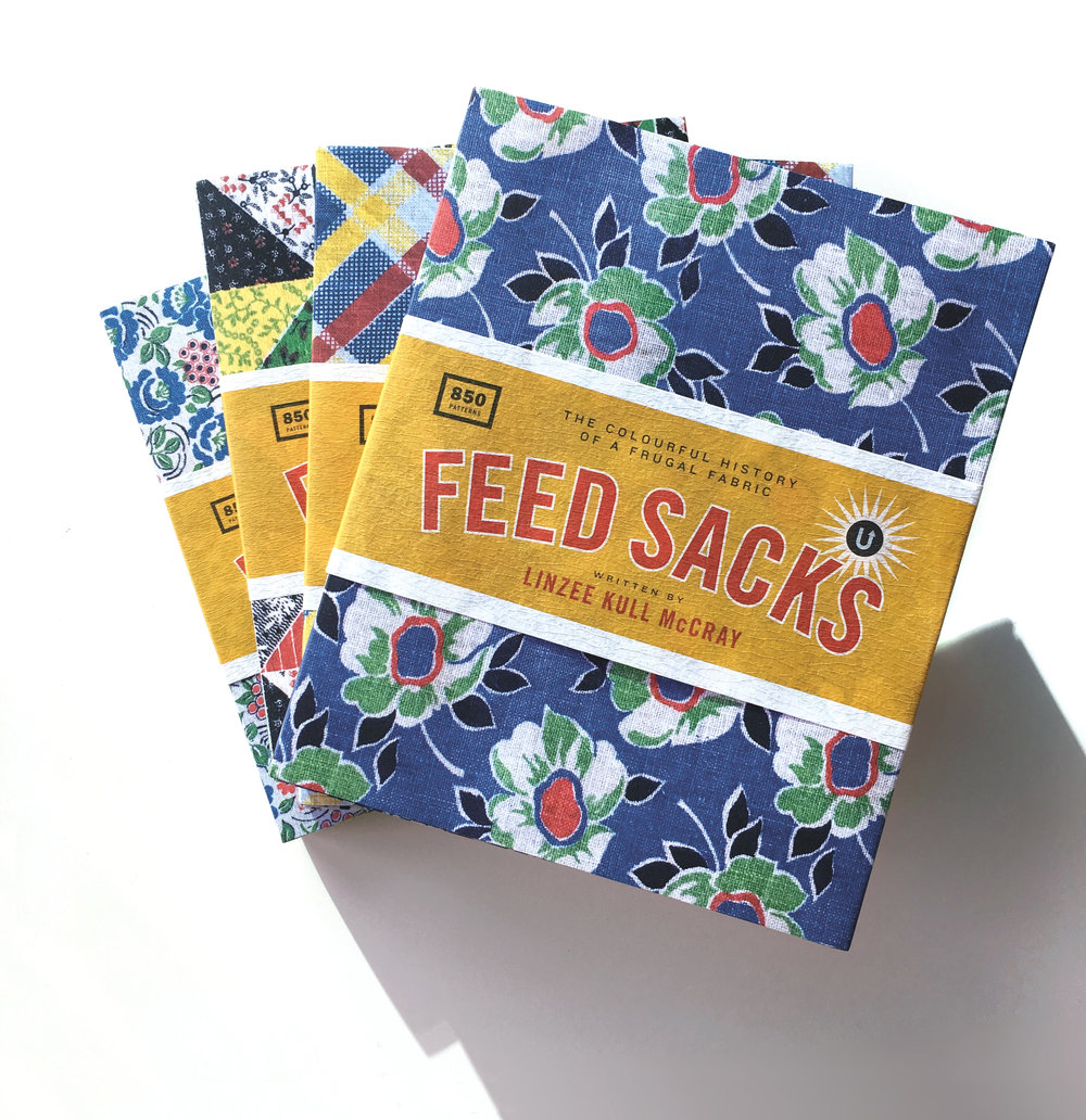 Feed Sacks comes with a dust jacket that can be refolded in four different ways to reveal four different feed sack designs (or you can use the paper for gift wrapping or craft projects!)