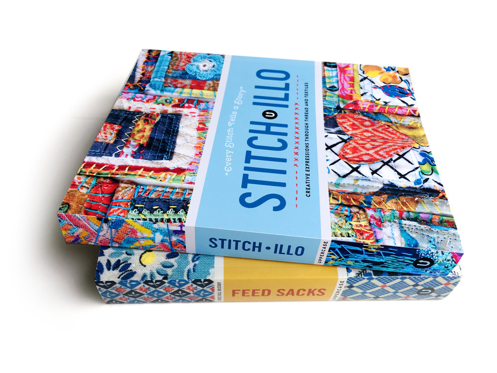 Stitch•illo  pictured with a printed copy of  Feed Sacks: The Colourful History of a Frugal Fabric  (text by Linzee Kull McCray)