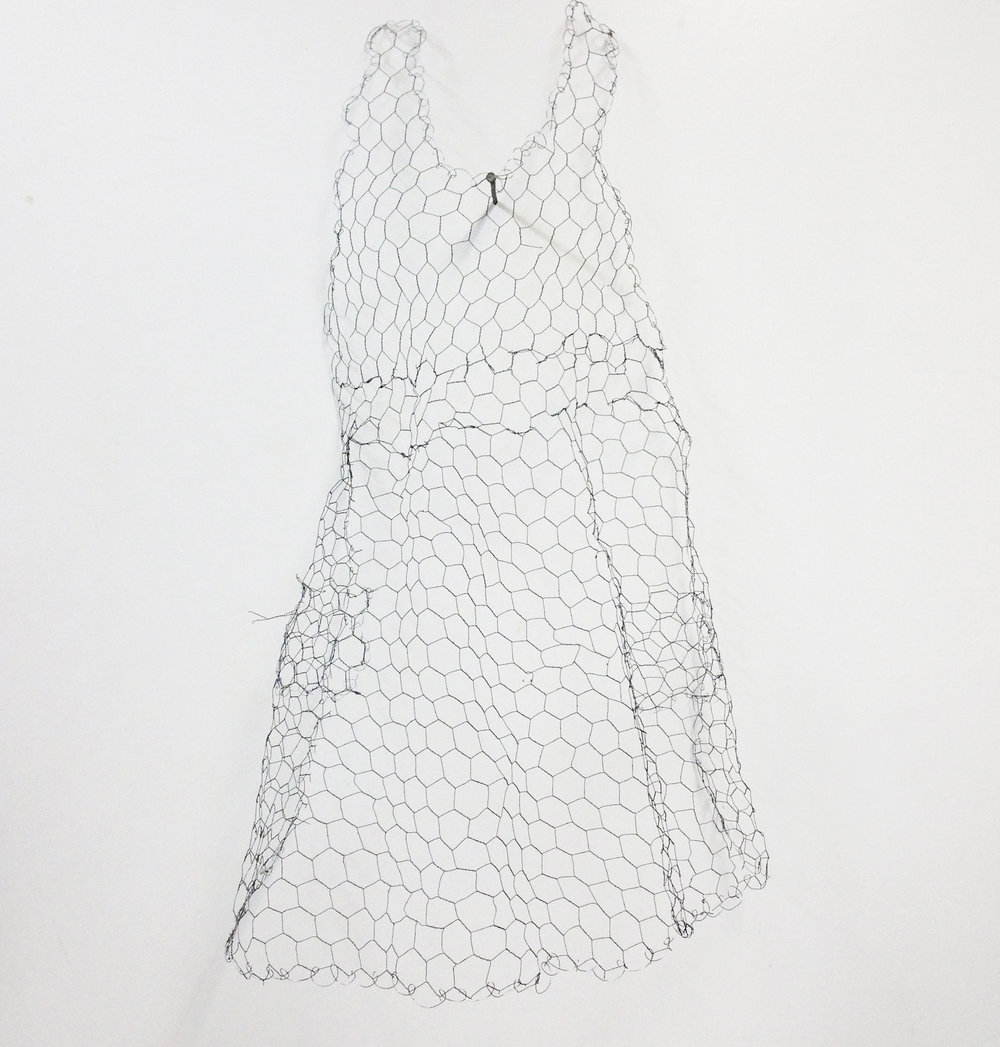 Apron made from chicken wire.