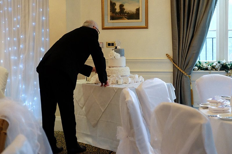 father-of-the-bride-inspecting-wedding-cake.jpg