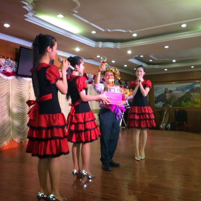 At Pyeongyang Restaurant  , Phnom Penh, Binh gets a birthday surprise from the North Korean waitresses  !