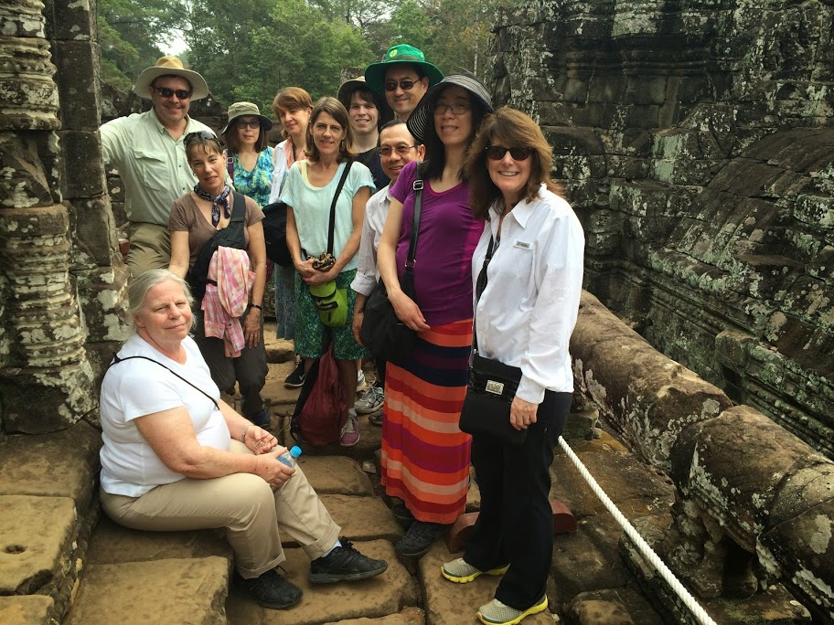 At Angkor Thom - Katherine, Susan, John, LInda, Susan, Suzie, Mathew, Ken, Binh, Debbie, Lisa (clockwise from left)