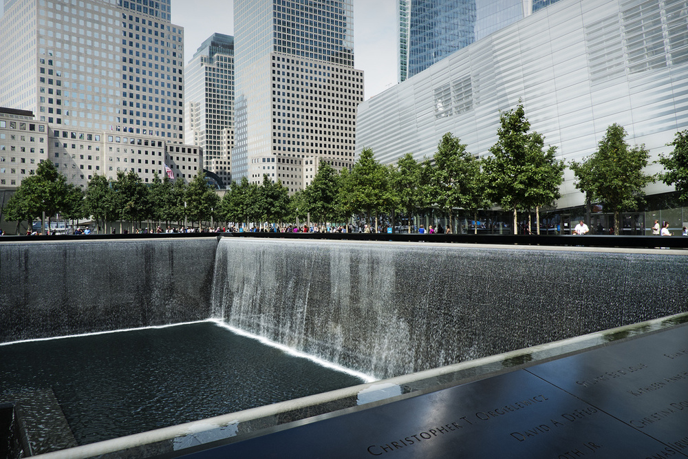 If you are in NYC, definitely get (free) tickets the the 9/11 memorial. It's incredible, and incredibly moving. It's very emotional to stand right next to the footprints of the Towers, and to think about all those who died that day. X-Pro1 with 18mm.