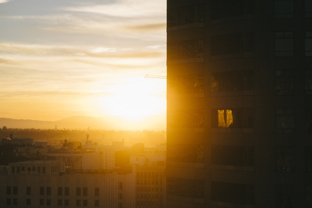 Another shot from DTLA, this time in the morning as the sun rose. Love the reflection in that one window. 61mm f/2.8, ISO 200, 1/850s