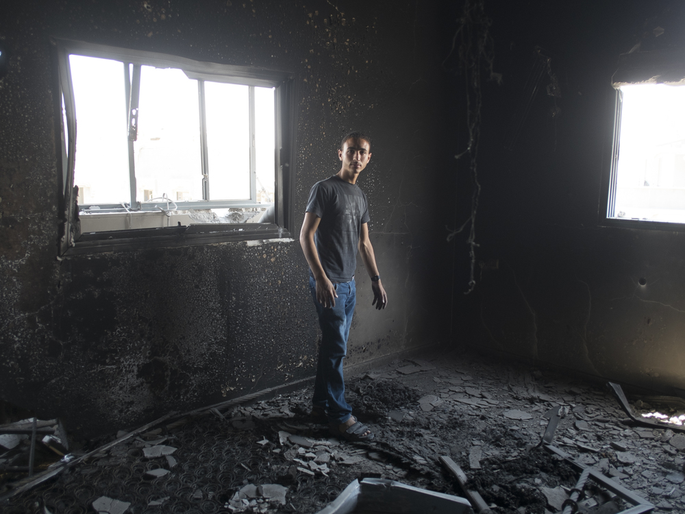 A boy in his destroyed bedroom in  Shuja'iyya , Gaza, July 26, 2014.