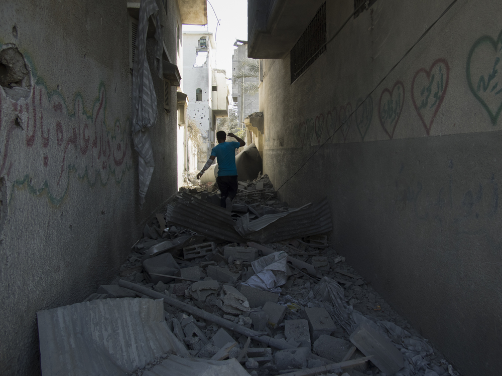 Shuja'iyya  district during an Israeli airstrike, Gaza City, July 23, 2014.