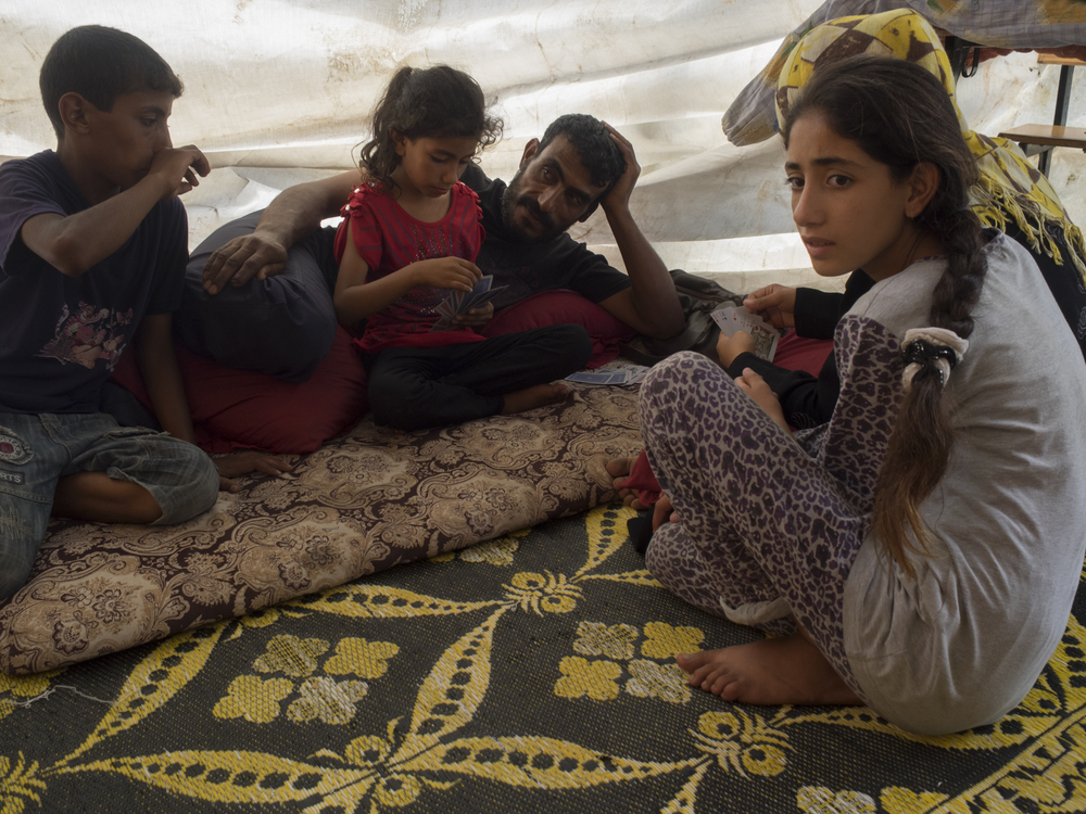 The family of Najlaia Abd El A'al, from Beit-Hanoun, living in a temporary shelter in the courtyard of the UNWRA school, Gaza City, July 20, 2014.