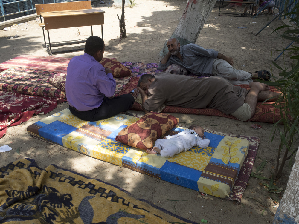Families sleeping in the courtyard of an UN school, Gaza City, July 20, 2014.
