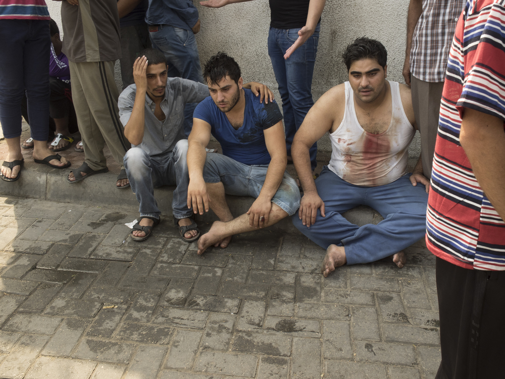 Men outside Al-Shifa hospital, Gaza City, July 20, 2014.