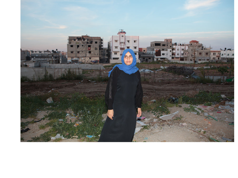"Shuja'iyya, Gaza Eslam Shamali stands amid the rubble of her destroyed home. Eslam's brother was a Hamas commander who died fighting in this neighborhood during the 2014 War. Her mother, father, and another brother were killed in the family's home, which was destroyed during the same battle.   ""For me as an adult, it's not a big deal for me to hear the sound of the drones, if it is in the night or the day, I got used to that and I know that it's not something healthy for my psychological situation, but that's the reality."""