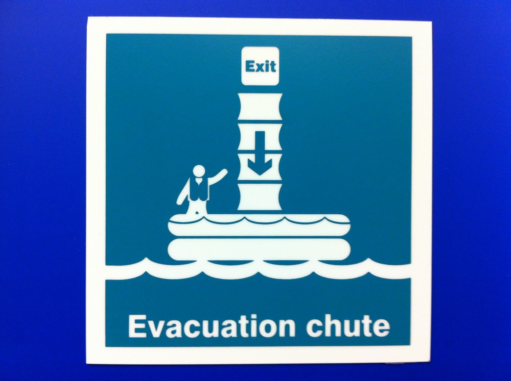 "In case of an emergency, ride the ""All new fun chute into the inflatable party pool!"""