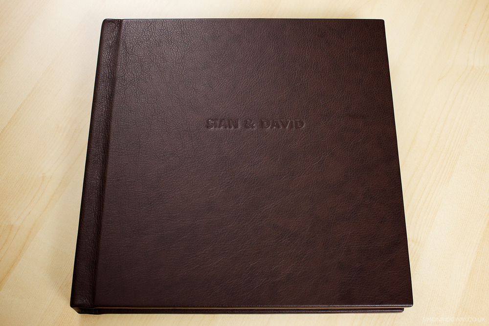 "12x12"" brown leather album with embossing"