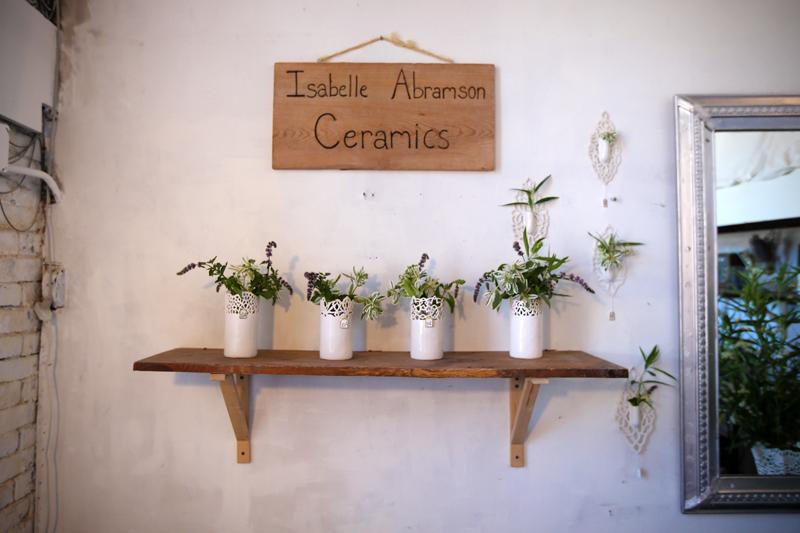 Isabelle Abramson's intricately detailed handmade ceramic vases on display in her studio