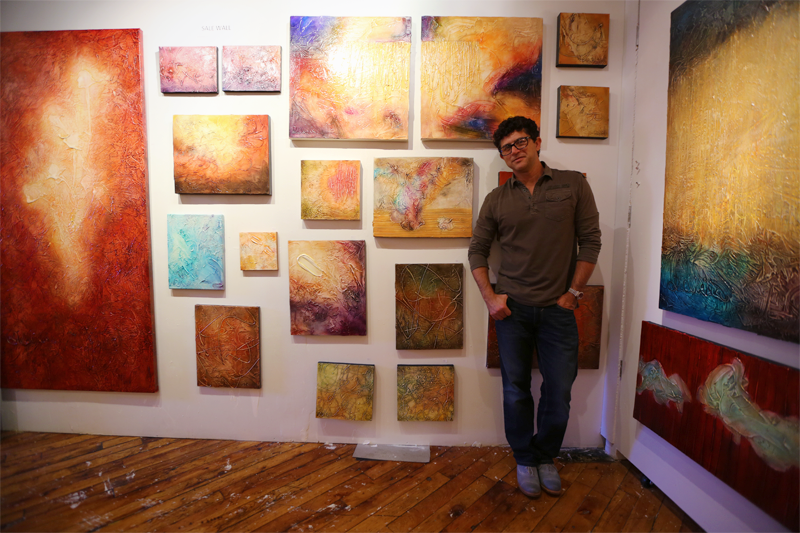 "Fernando DeOliveira's vibrant and highly textured abstract artwork. The best way to describe seeing his work in person is that it was ""larger than life""! It was so bright and fun to be around."