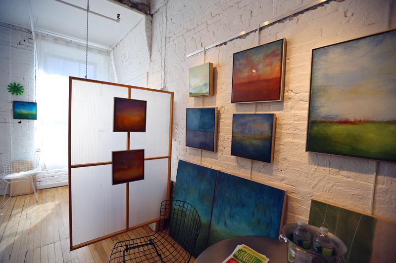 Linda Cordner's studio full of abstract encaustic paintings